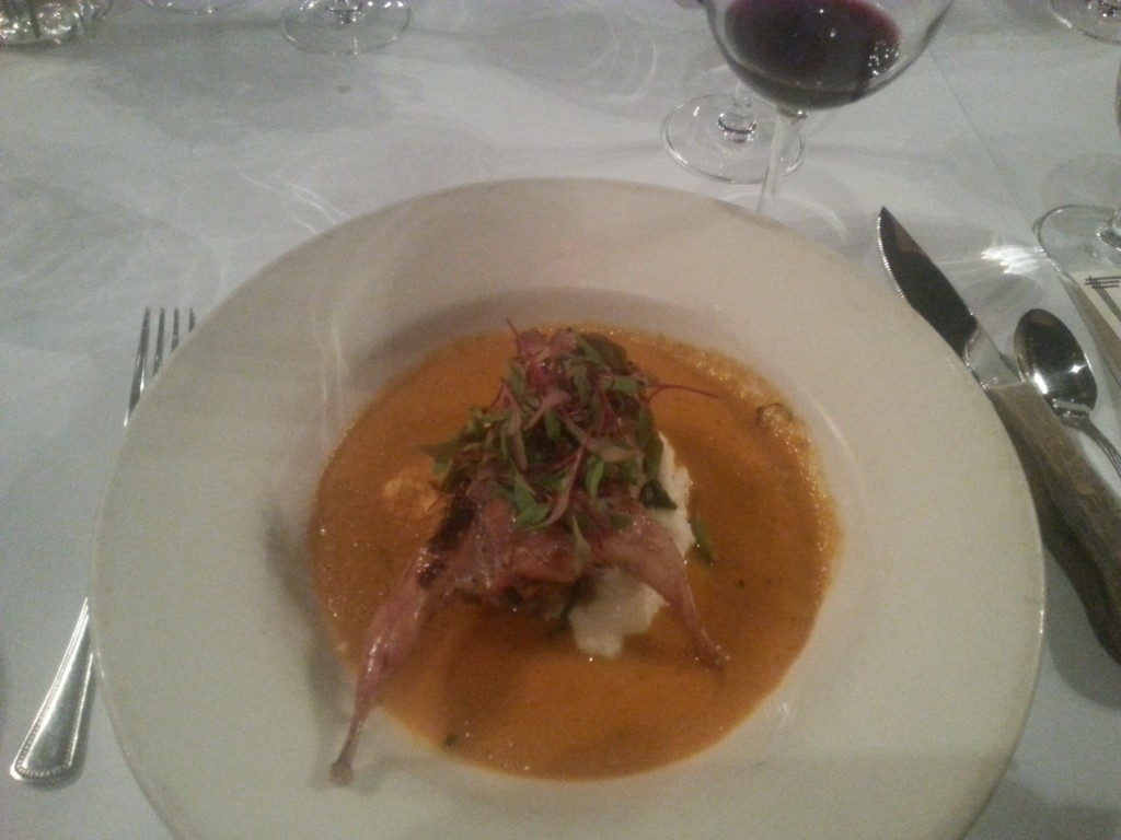 quail, stuffed with a rib eye chorizo boudin surrounded by a smoked tomato broth, spinach, pine nuts, and golden raisins