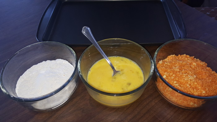 Set out your breading station. You'll coat the sticks with flour first, then egg, and finally the Cheetos.