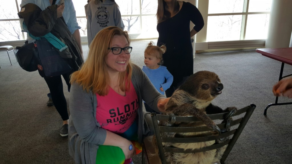 Quirky Chrissy petting the adorable Steve the Sloth.