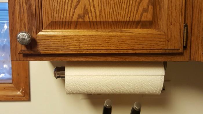 Paper towel holder underneath cabinet