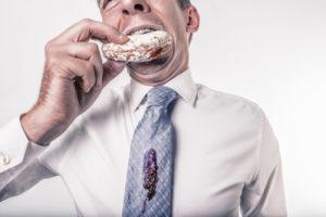 man spills jelly donut on tie