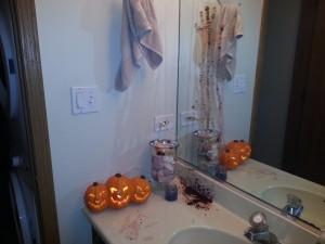Bloody hand print on the mirror-scary Halloween bathroom decor