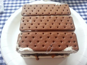 Make your own ice cream cake using ice cream sandwiches, chocolate sauce, caramel and cool whip for an easy, delicious treat   Ice Cream Sandwich Cake