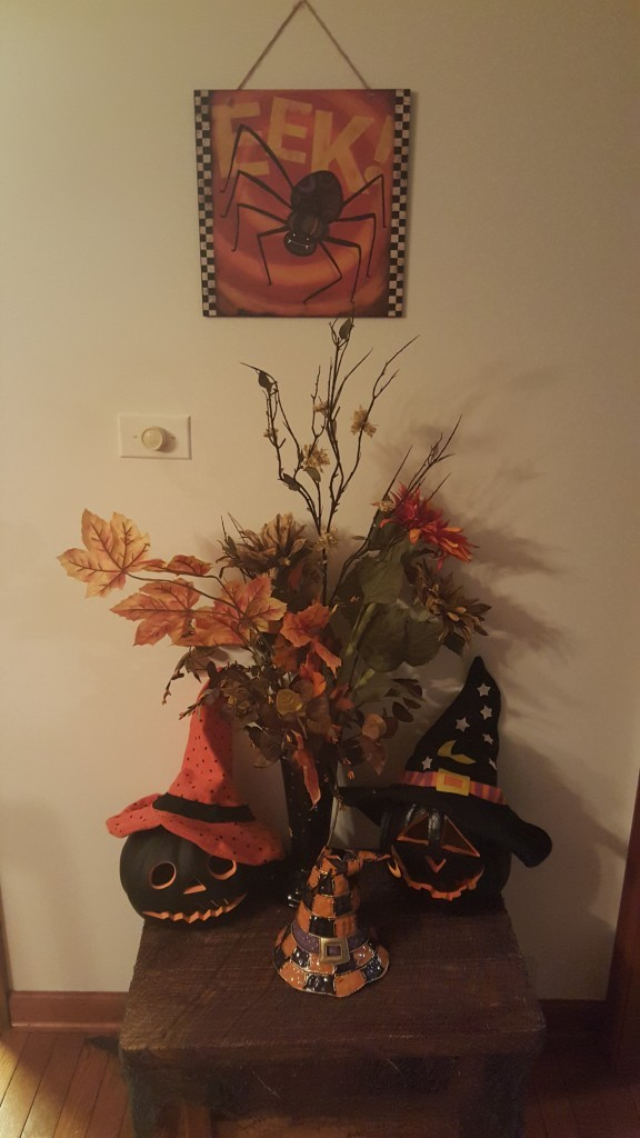 I love this display of light-up electric pumpkins with witches hats, creepy cloths and fall foliage