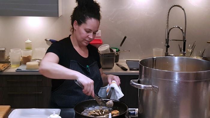 Chef Stephanie Izard prepares shrimp at a demo for Canadian Lentils
