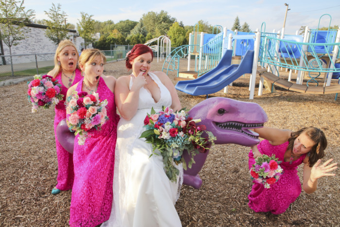 we took wedding photos at a playground, and had so much fun on the purple dinosaur.