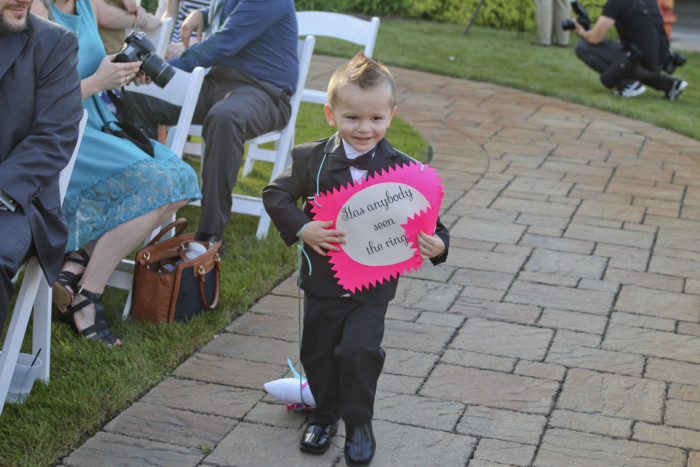 """Our ring bearer had a sign that said """"Has anybody seen the rings?"""" and dragged the ring pillow behind him."""