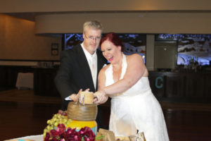 As I was cutting the cheese cake with my new husband., we kept laughing