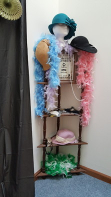 Photo booth station with costume add-ons for a 20s themed bachelorette party