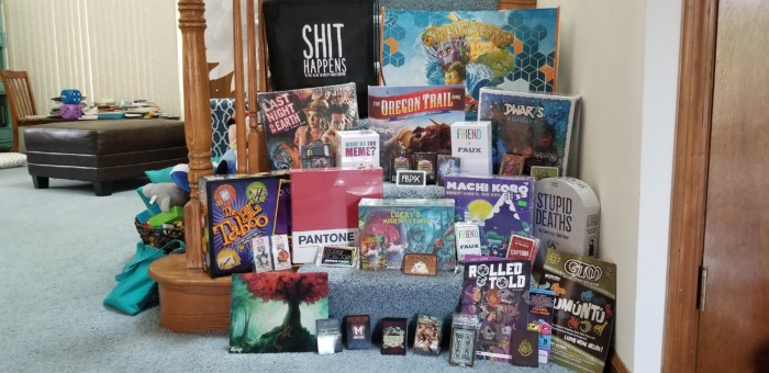 Games and swag I picked up at Gen Con 2018