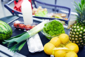 Group of food products on supermarket checkout