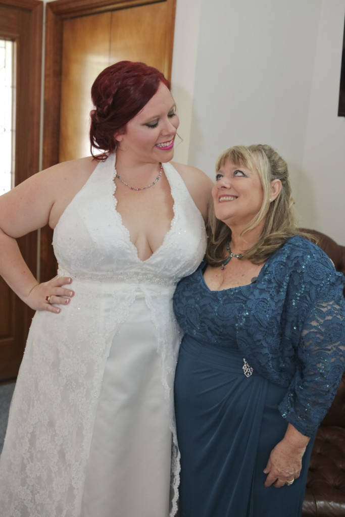 funny professional wedding photos Chrissy and her mom making faces at each other