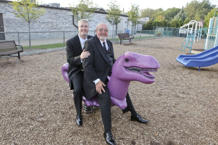 hilarious professional wedding photos  at a playground