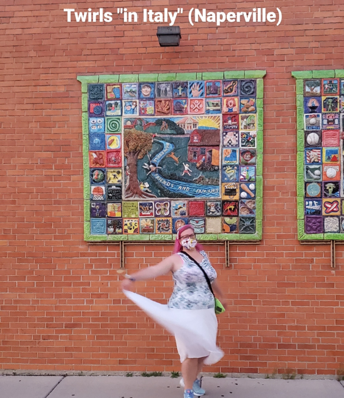 """Chrissy twirling in front of a mural in downtown Naperville with the caption """"twirls in 'Italy' (Naperville)"""""""