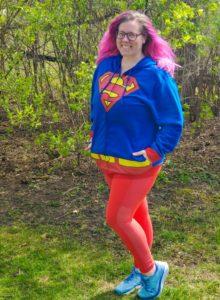 Chrissy posing in a Superman hoodie
