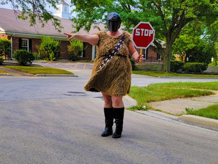 Mandolorian Wookie Woman with a stop sign